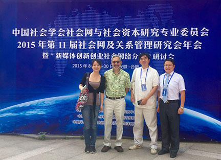 George Barnett with three participants at a 2015 social network conference in China.